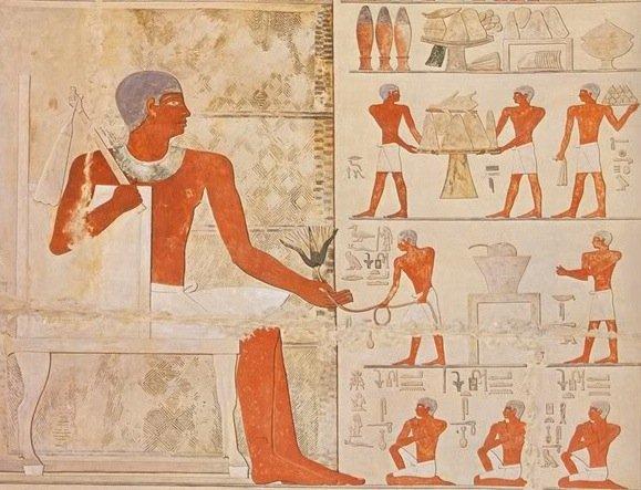 Particolare di un bassorilievo della tomba G5170 di Giza, dove si osserva Seshemnofer III che consegna un fiore di ninfea al fratello defunto Seshemnofer II (2350 a.C. circa)